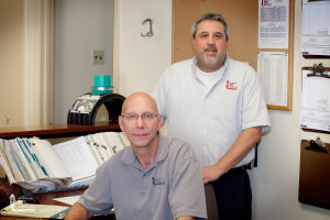 Dave Bode (seated), Valley Grove Branch Manager | TG Tsoras, Purchasing Manager